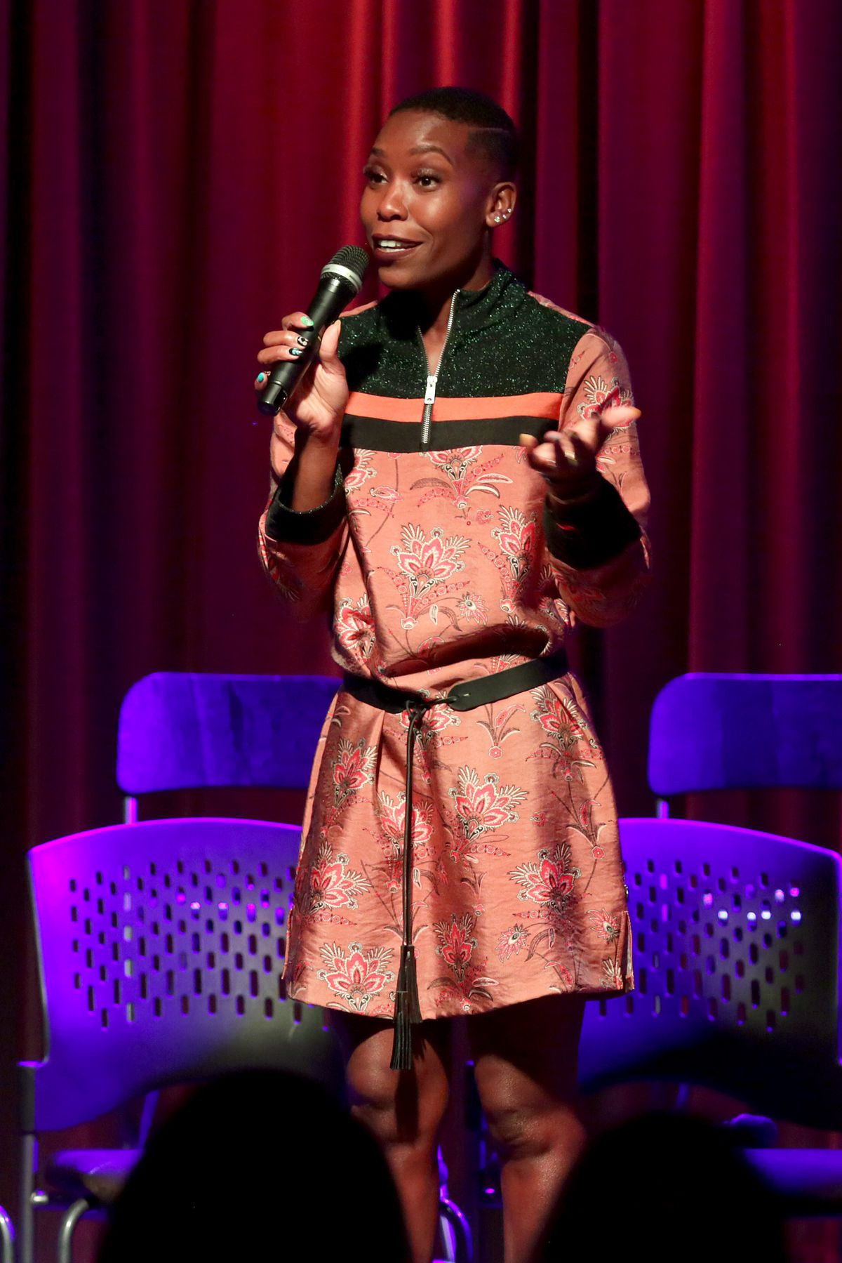 A photo of Nwaka Onwusa speaking onstage at A Conversation With Jermaine Dupri & Friends at the Grammy Museum in 2018