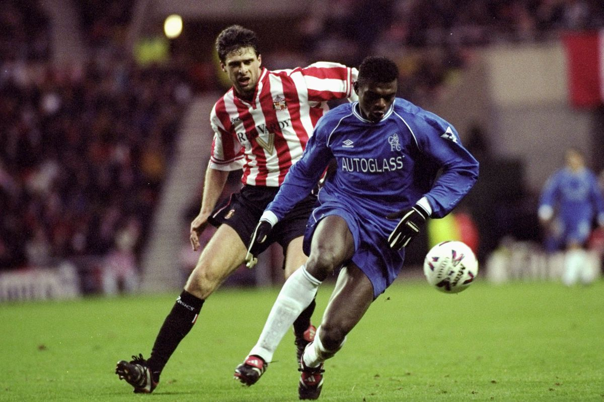Niall Quinn putting pressure on Chelsea's Marcel Desailly