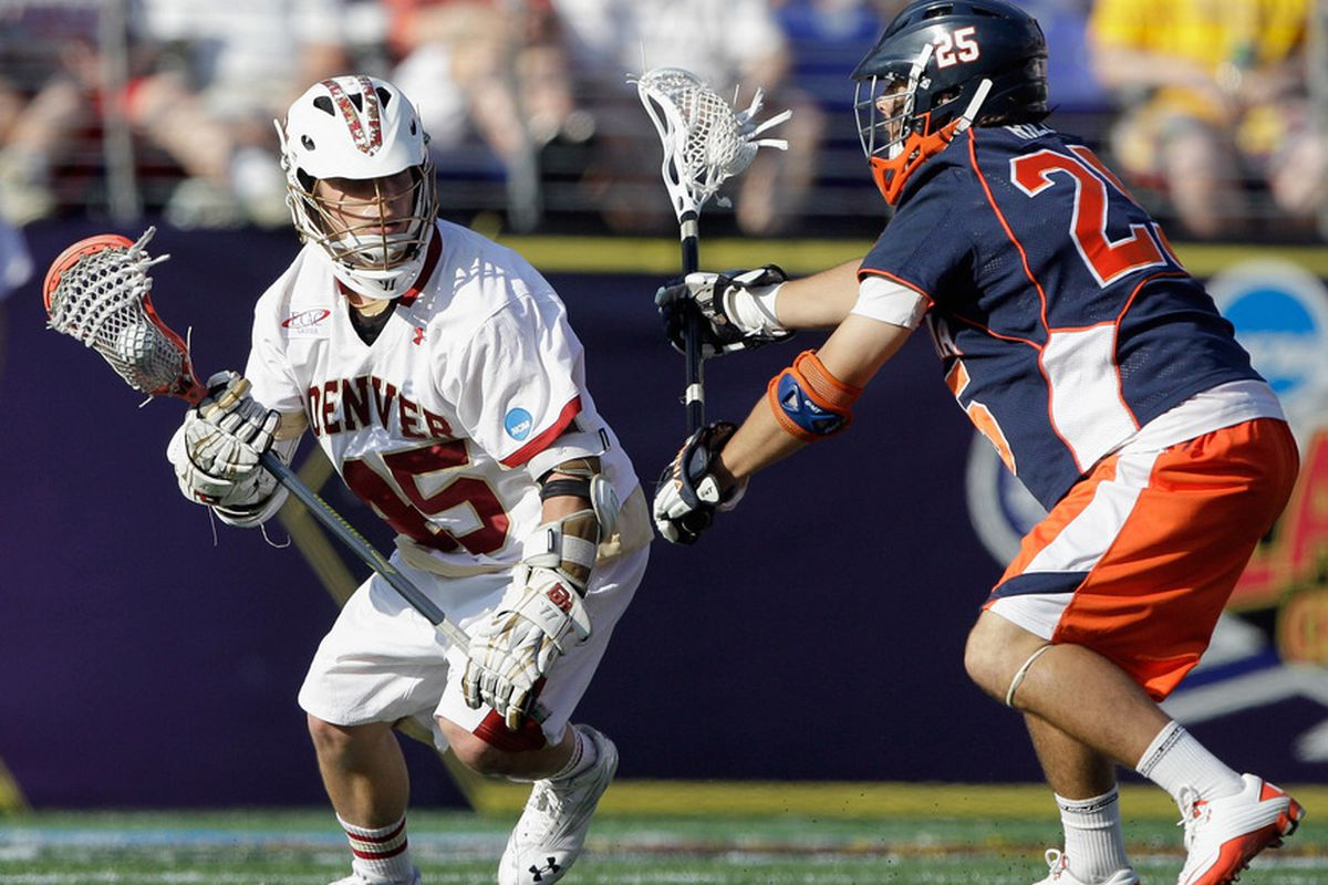 BALTIMORE, MD - MAY 28: Jeremy Noble #45 of the Denver Pioneers works the ball around Blake Riley #25 of the Virginia Cavaliers during the second half at M&T Bank Stadium on May 28, 2011 in Baltimore, Maryland.  (Photo by Rob Carr/Getty Images)