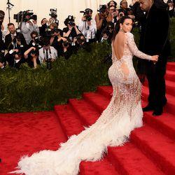 Kim Kardashian in Roberto Cavalli and Kanye West