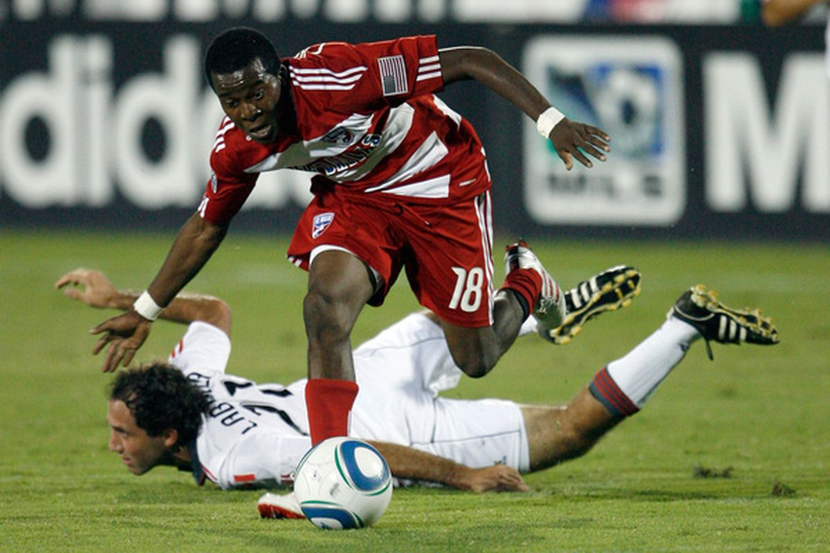 FRISCO TX - SEPTEMBER 04:  Midfielder Marvin Chavez #18 of FC Dallas dribbles the ball past midfielder Nick LaBrocca #21 of Toronto FC on September 4 2010 at Pizza Hut Park in Frisco Texas.  (Photo by Tom Pennington/Getty Images)