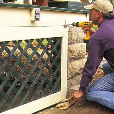 Man Hangs Framed Lattice Panels From Porch With T-Hinges