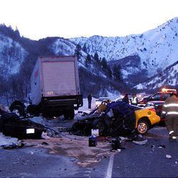 A Ryder moving truck heading southbound on US 89/91 veered into the northbound lane and crashed head-on into an yellow Saturn and black Audi. The driver of the Saturn was pronounced dead at the scene. The two 17-year-old male occupants of the Audi are in extremely critical condition at LDS and McKay Dee Hospitals. Utah Highway Patrol Photo
