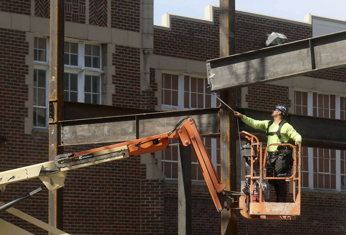 Construction crews build an extension of the Florence J. Gillmor Hall at Westminster College in Salt Lake City on Wednesday, June 16, 2021.