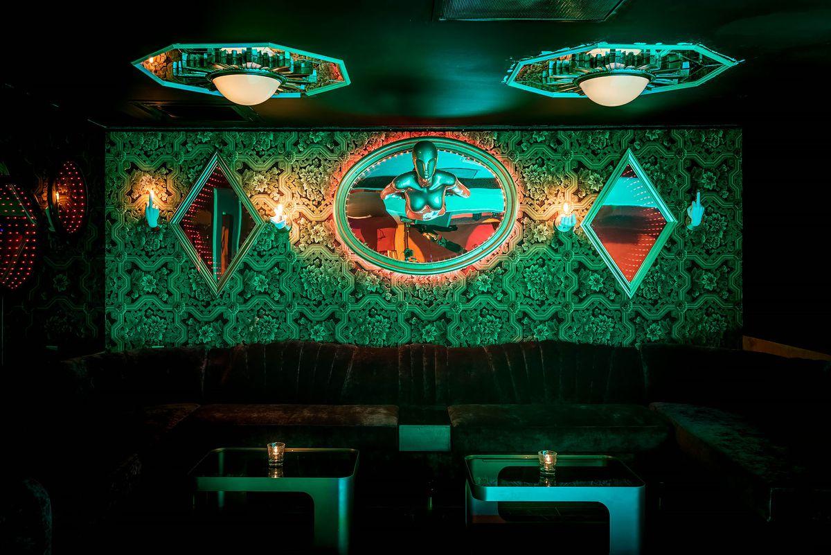 Dark green lit lounge at Kiss Kiss Bang Bang, Koreatown.