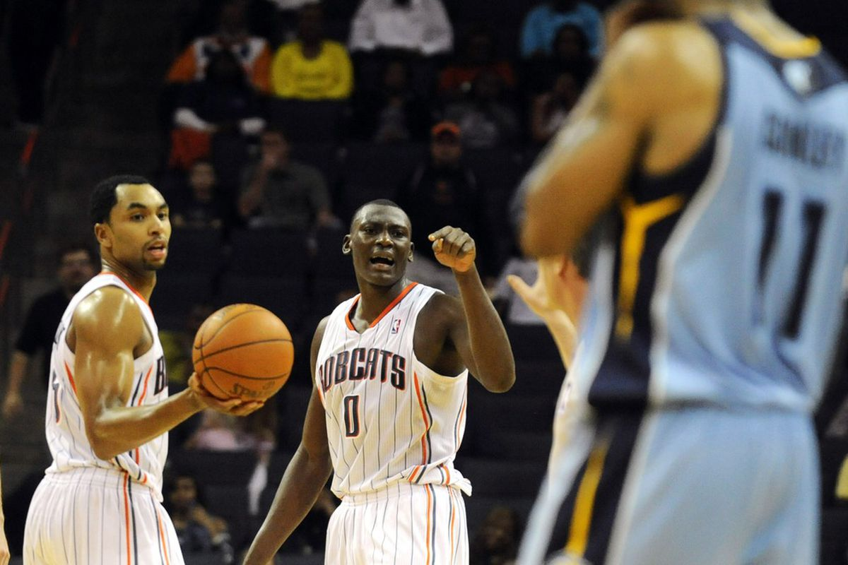 April 20, 2012; Charlotte, NC, USA; Charlotte Bobcats center Bismack Biyombo (0) talks for Memphis Grizzlies guard Mike Conley during the game at Time Warner Cable Arena. Grizzlies win 85-80. Mandatory Credit: Sam Sharpe-US PRESSWIRE