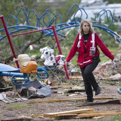 Jill Orton, executive director of the Loess Hills chapter of the Red Cross, walks through a wrecked playground as she surveys damage in Thurman, Iowa, Sunday, April 15, 2012. A large part of the town in the western part of the state was destroyed Saturday night, possibly by a tornado, but no one was injured or killed. Fremont County Emergency Management Director Mike Crecelius said about 75 percent of the 250-person town was destroyed.