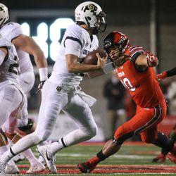 Colorado Buffaloes quarterback Steven Montez (12) comes under pressure from Utah Utes linebacker Sunia Tauteoli (10) at Rice-Eccles Stadium in Salt Lake City on Saturday, Nov. 25, 2017.