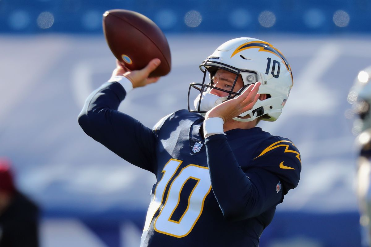 Justin Herbert #10 of the Los Angeles Chargers warms up prior to the game against the Buffalo Bills at Bills Stadium on November 29, 2020 in Orchard Park, New York.