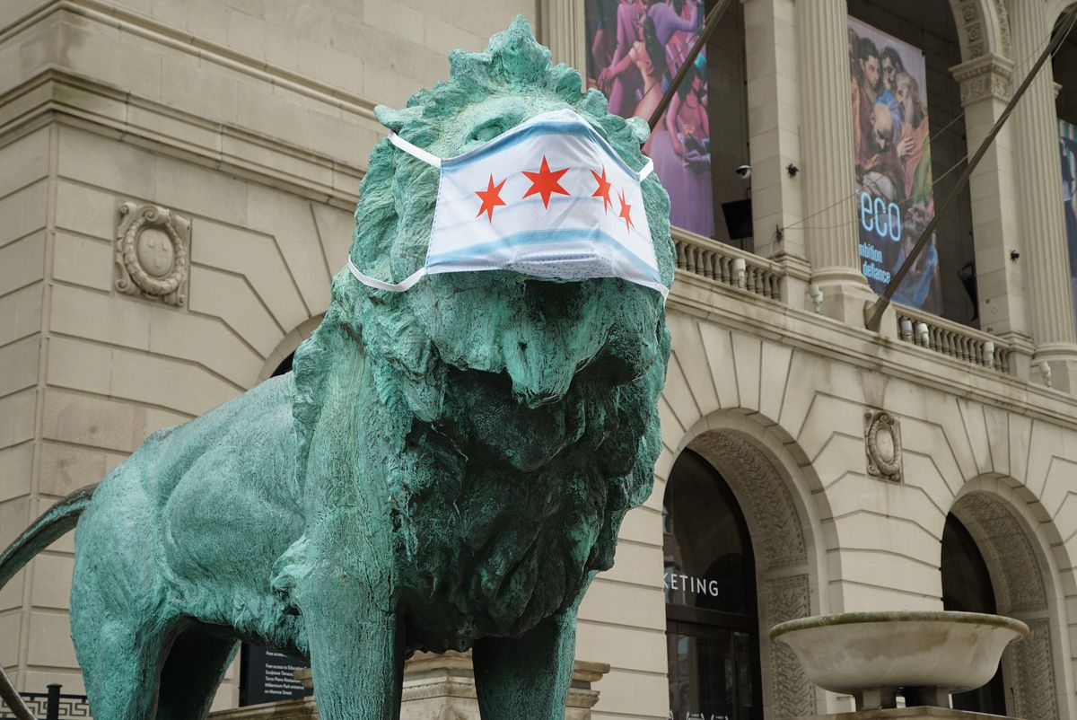 The iconic lion statues wear face masks outside the The Art Institute of Chicago last May, one day ahead of a statewide mandate requiring masks in public places.