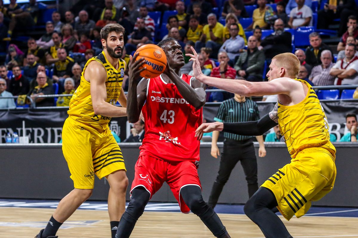 Amar Sylla, #43 of Filou Oostende and Aaron White, #30 of...