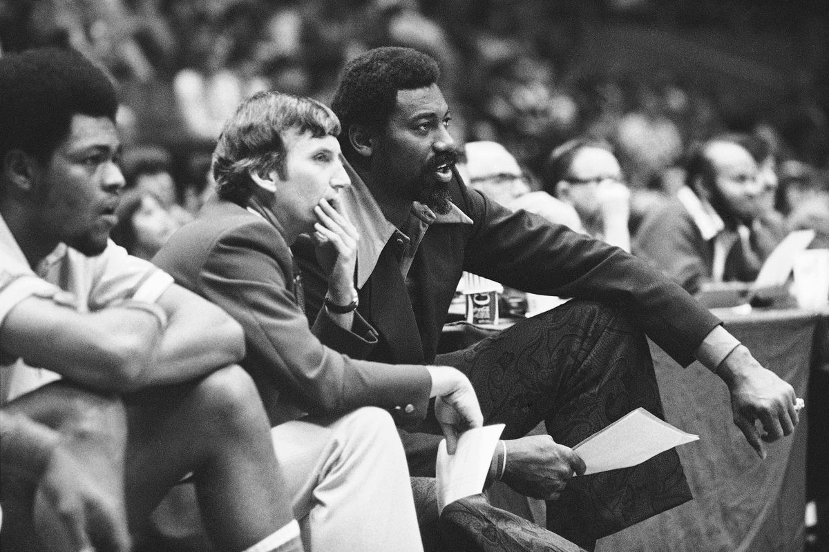 In this 1974 photo, Wilt Chamberlain, right, coach of the ABA's San Diego Conquistadors, and assistant coach Stan Albeck, middle, watch in the opening minutes of the team's game against the New York Nets. Albeck died Thursday at age 89.