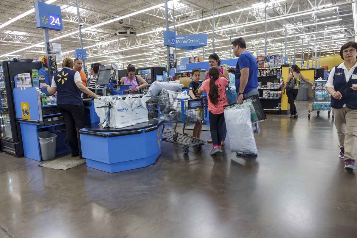 A family at checkout inside a Walmart in Miami. Jeffrey Greenberg/UIG via  Getty Images ...