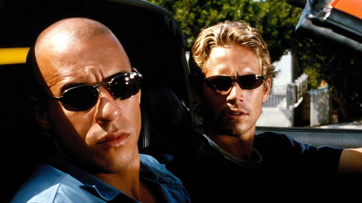Vin Diesel and Paul Walker sit in a car together in 2001's The Fast and the Furious