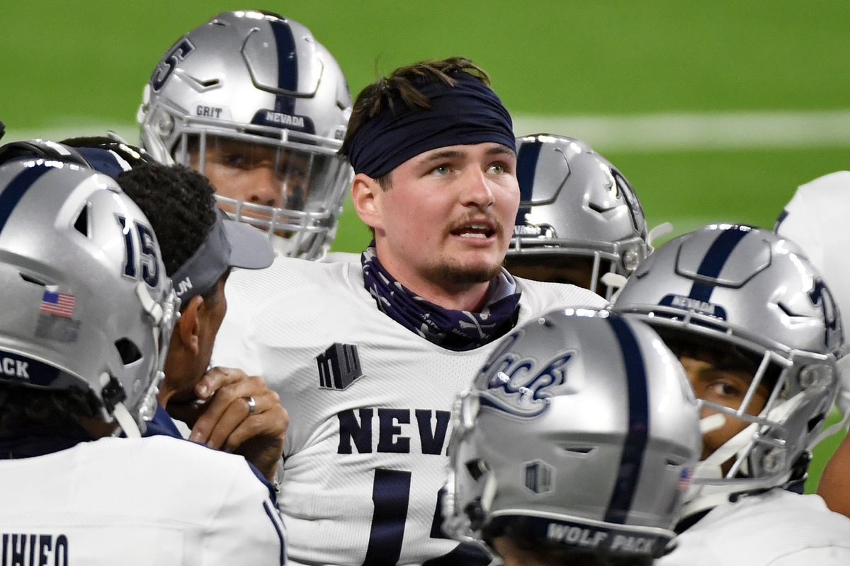 Quarterback Carson Strong of the Nevada Wolf Pack stands with teammates during a timeout in the first half of their game against the UNLV Rebels at Allegiant Stadium on October 31, 2020 in Las Vegas, Nevada. The Wolf Pack defeated the Rebels 37-19.