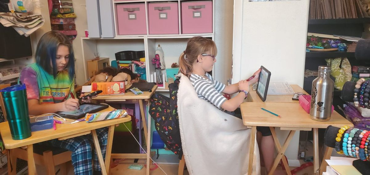 Mandy Babb's daughters work from home during Jeffco Public School's first day doing remote learning.