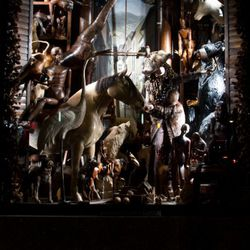 The wood window features marionettes as well as animals.