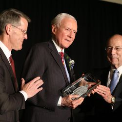 Sen. Orrin Hatch, center, receives the BYU Management Society's 2017 Distinguished Utahn Award from Gary Snyder, left, and Deseret Management Corp. CEO Keith B. McMullin in Salt Lake City on Thursday, June 1, 2017.
