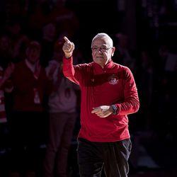 Former head coach Dick Bennett walks onto the Kohl Center floor to a standing ovation.