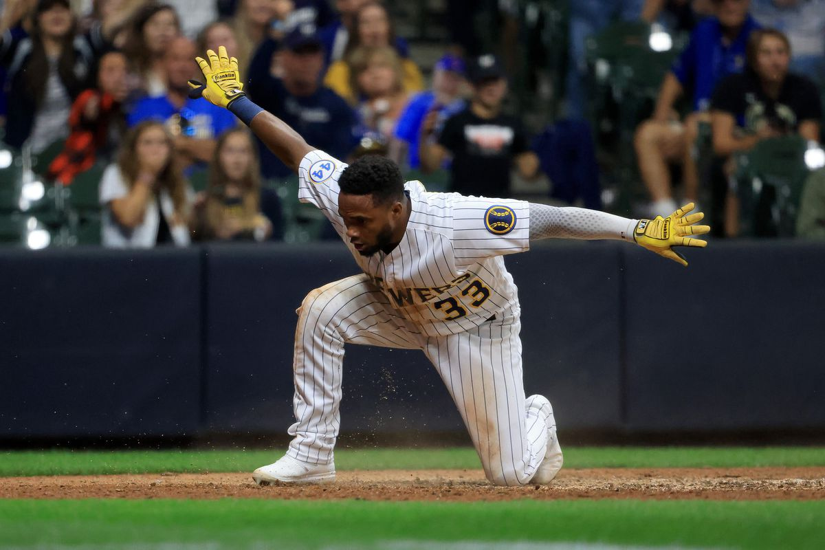 Pablo Reyes of the Milwaukee Brewers reacts after scoring a run during the eighth inning in the game against the Chicago Cubs at American Family Field on September 18, 2021 in Milwaukee, Wisconsin.