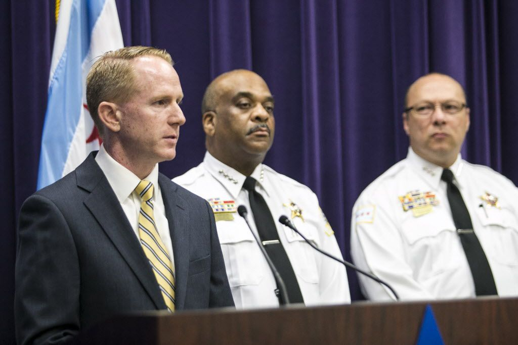 Area Central Detectives Cmdr. Brendan Deenihan (left), speaks during a news conference about the arrests of a former Northwestern University professor and an Oxford University employee in connection with the fatal stabbing in a River North high-rise.   As