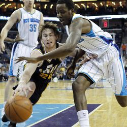 Utah Jazz shooting guard Gordon Hayward (20) battles for a loose ball with New Orleans Hornets small forward Al-Farouq Aminu (0) in the first half of an NBA basketball game in New Orleans, Friday, April 13, 2012.