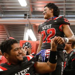 West's Kingsley Brown (22) cheers with his teammates before a high school football game against Roy High on Friday, Sept. 10, 2021, at West High School in Salt Lake City.