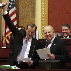 Rep. Ron Bigelow, R-West Valley, and Rep. Michael Noel, R-Kanab, sing a song as the final session of the 2009 Utah Legislature is adjourned at the Capitol Thursday.