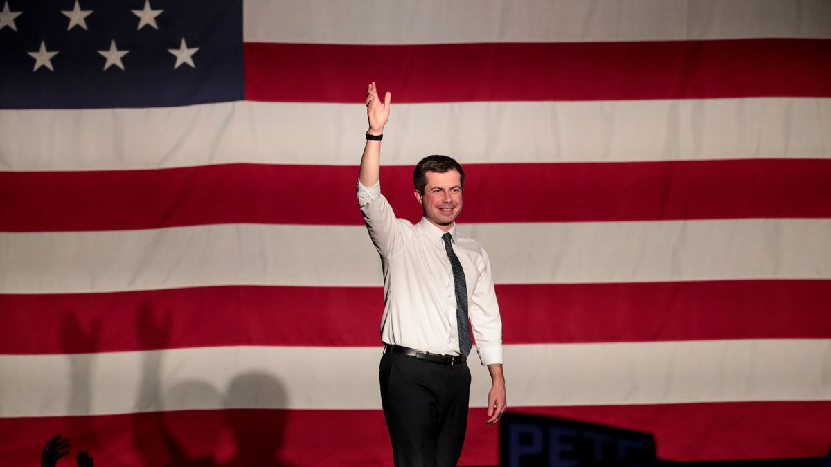Democratic presidential candidate Pete Buttigieg waves goodbye to the crowd at a town hall at The Union Event Center in Salt Lake City on Monday, Feb. 17, 2020.