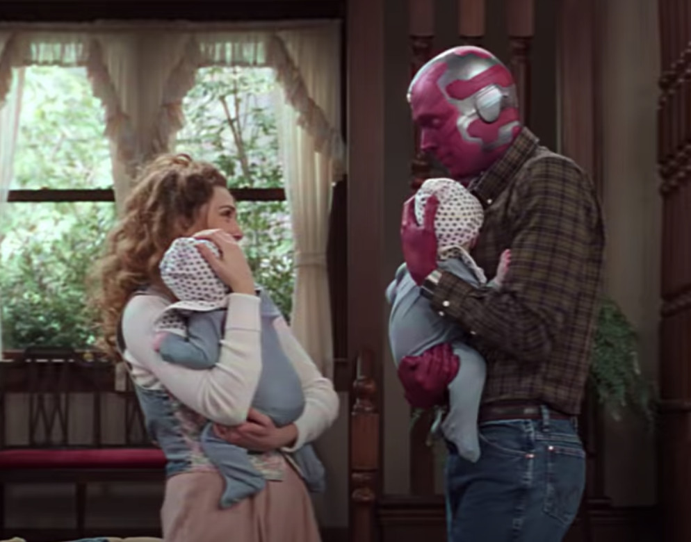 Wanda and Vision holding twins in WandaVision