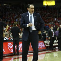 Coach Krzyzewski yells at an official during a timeout.