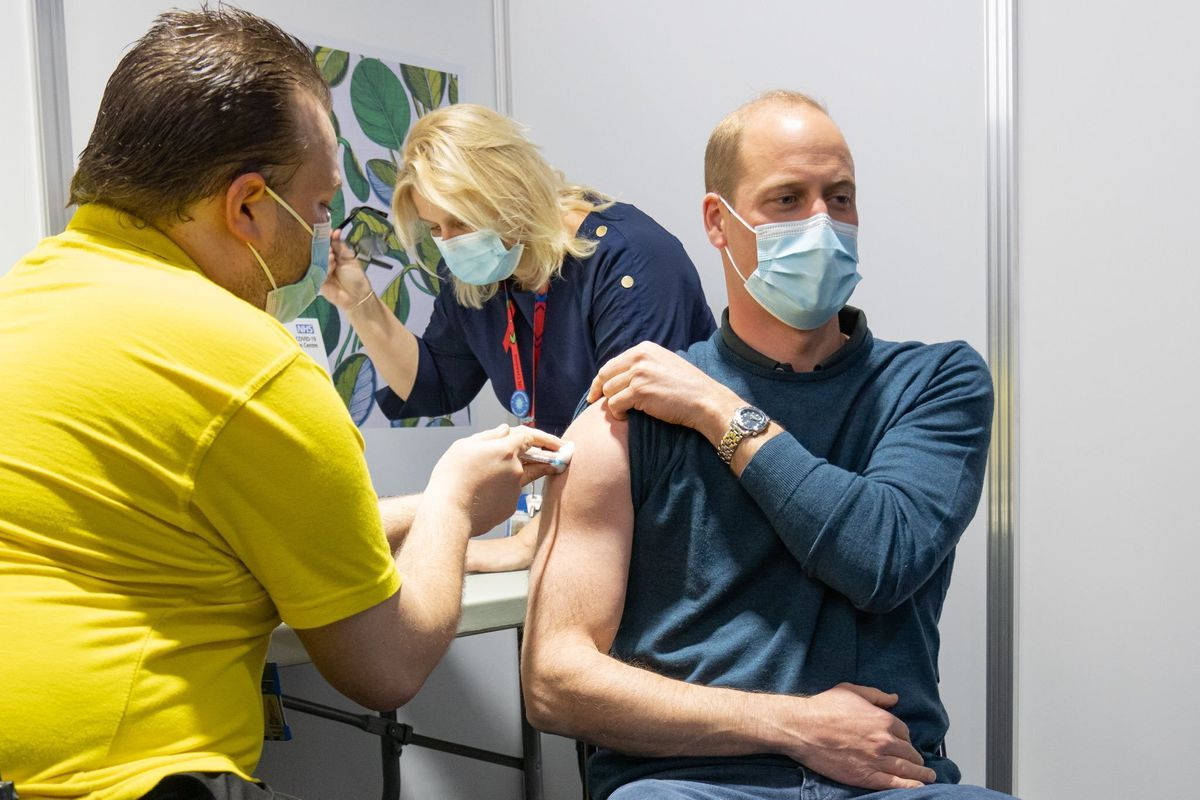 In this picture tweeted by the Duke and Duchess of Cambridge, Britain's Prince William receives his coronavirus vaccine in London on Tuesday.