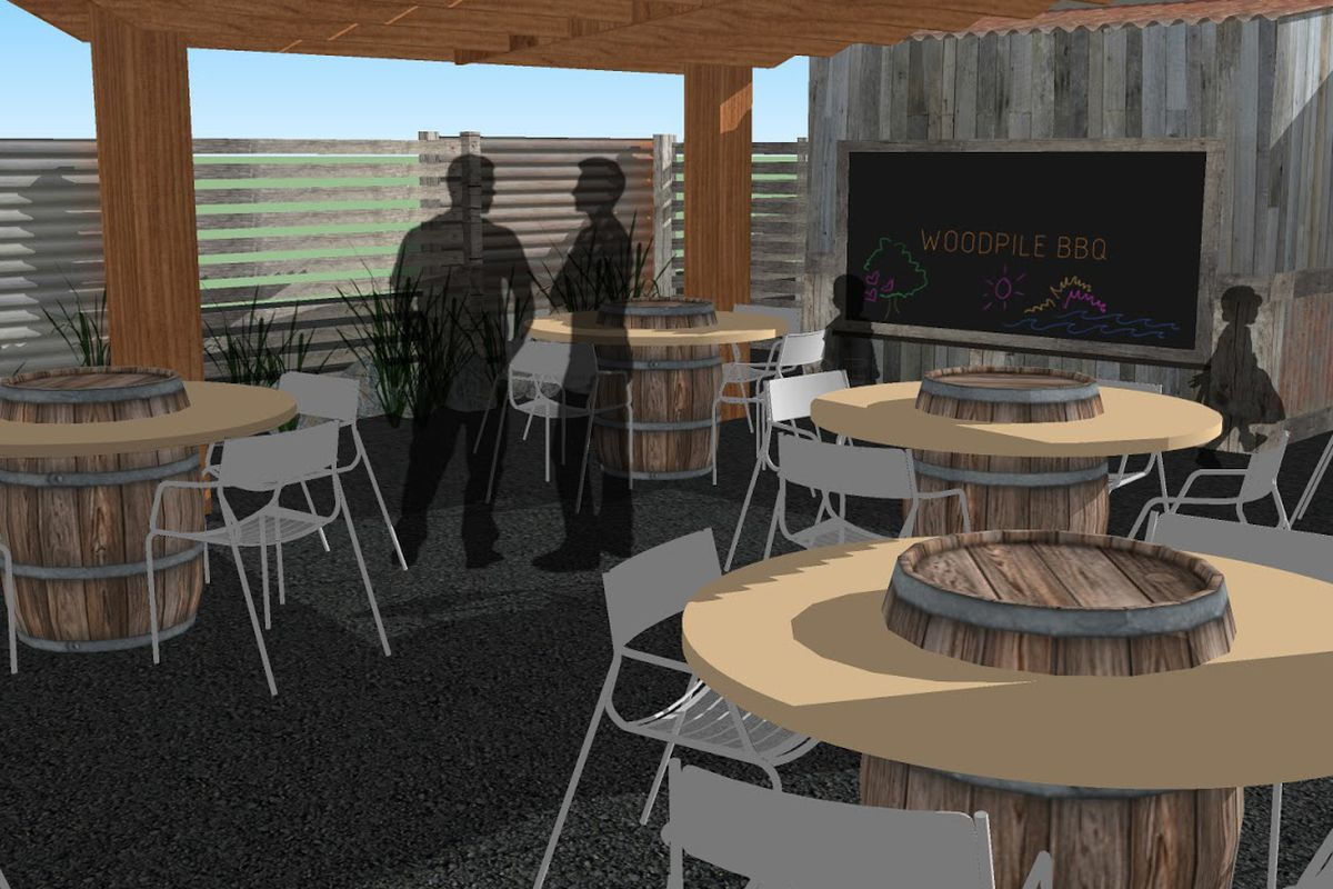 Patio seating will be centered around wooden barrel tables at Woodpile BBQ Shack.