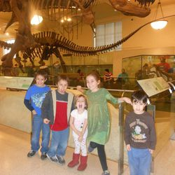 Homeschool co-op at New York City's American Museum of Natural History. Olive Ward is in the green dress. Younger sister June, 4, has red boots.