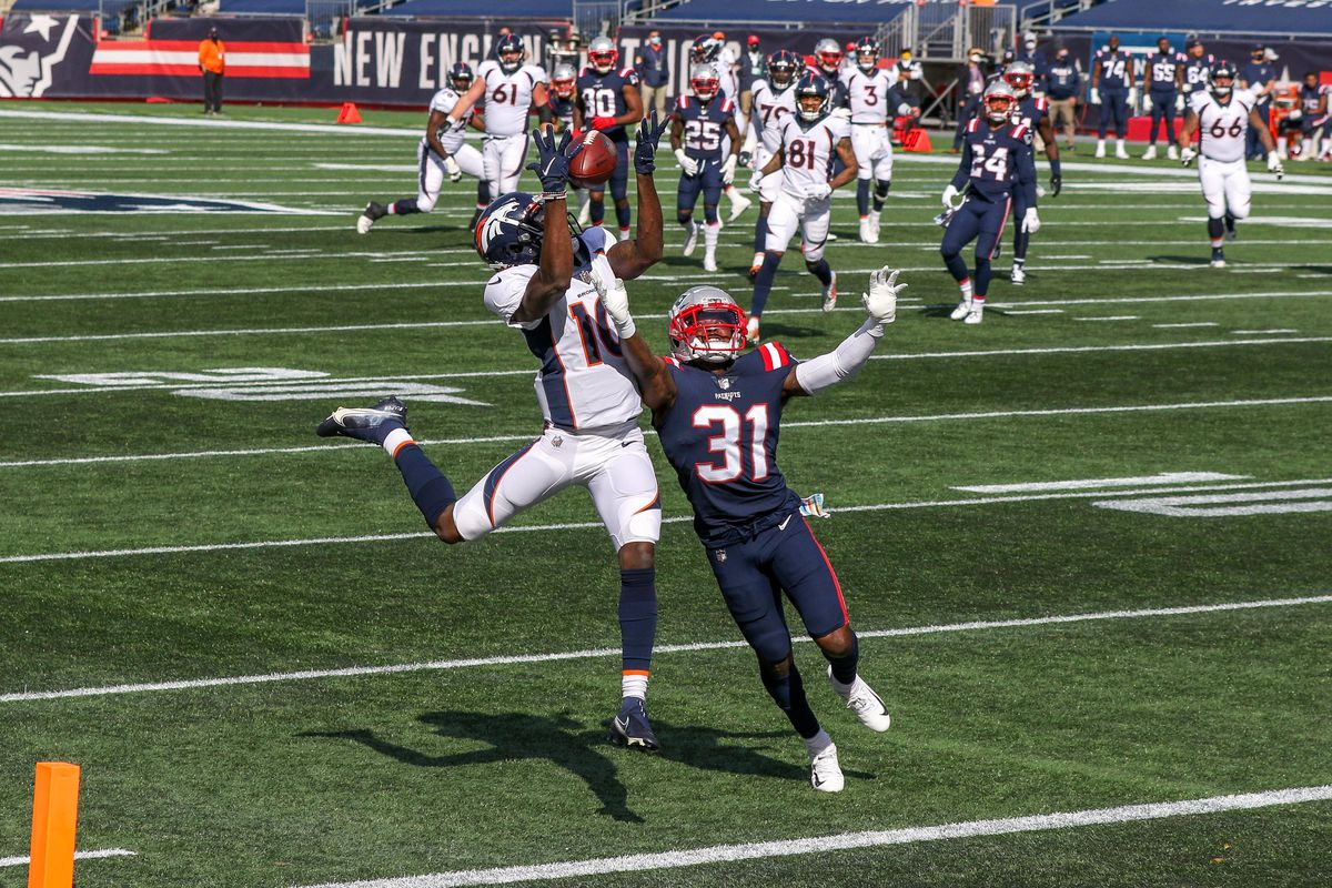 New England Patriots cornerback Jonathan Jones (31) breaks up a pass to Denver Broncos receiver Jerry Jeudy (10) during the first half at Gillette Stadium.
