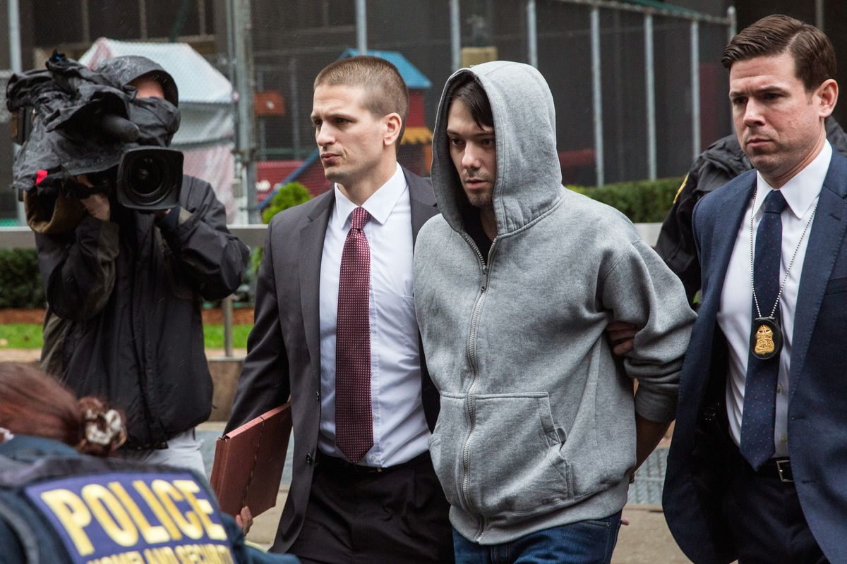 Shkreli, in the hooded sweater, being arrested on Thursday morning.