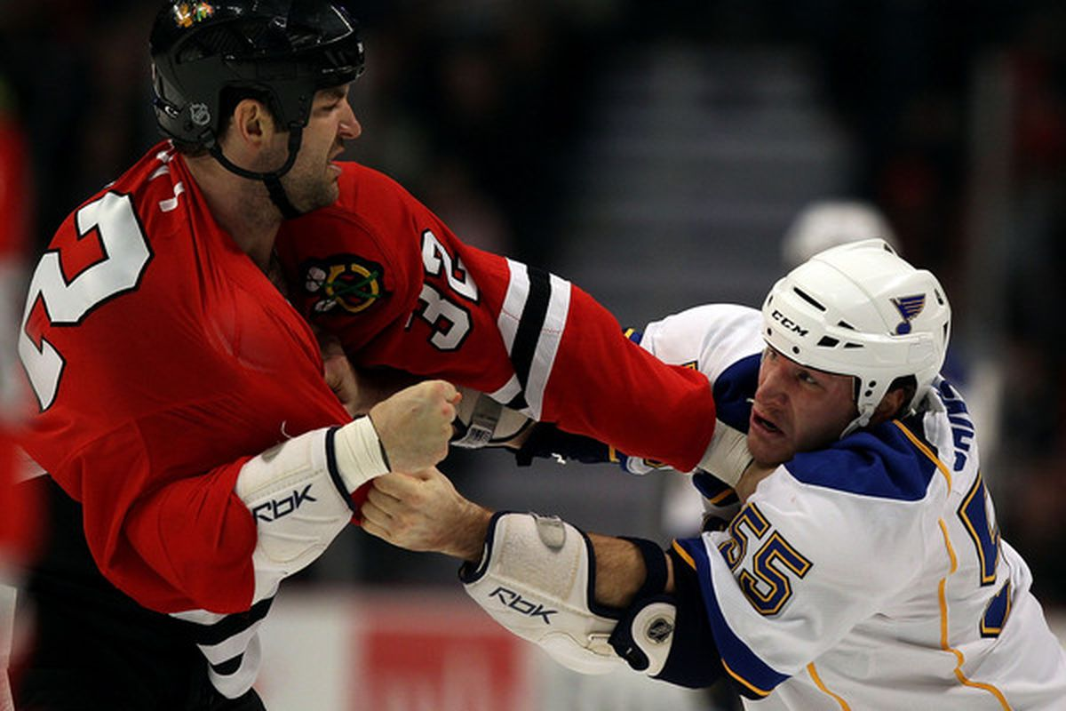CHICAGO - NOVEMBER 30: John Scott #32 of the Chicago Blackhawks fights with Cam Janssen #55 of the St. Louis Blues at the United Center on November 30 2010 in Chicago Illinois. (Photo by Jonathan Daniel/Getty Images)