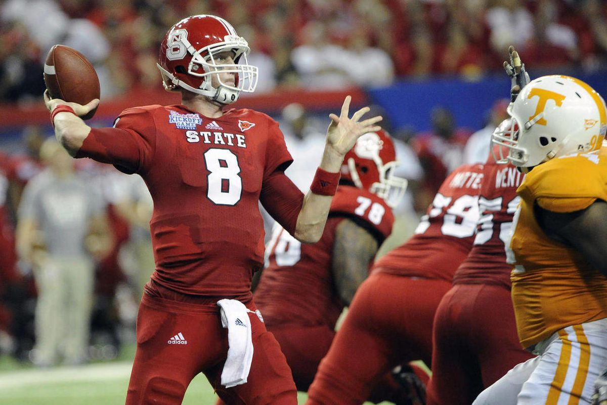 North Carolina State quarterback Mike Glennon (8) passes against Tennessee  during the second quarter of the Chick-fil-A Kickoff Game, beginning the NCAA college football season in the Georgia Dome, in Atlanta., on Friday, Aug. 31, 2012.