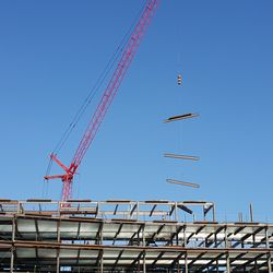 10:40 a.m. Steel being lifted by crane onto plaza building -