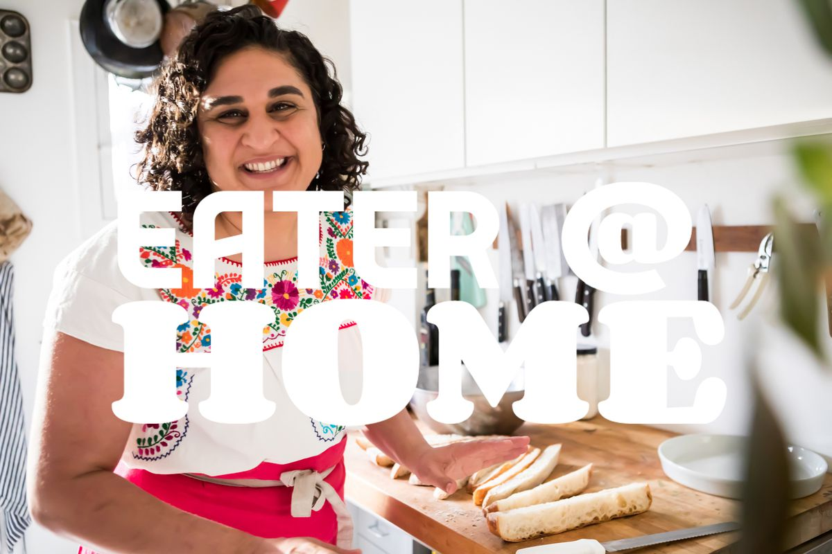 """Chef and cookbook author Samin Nosrat in her kitchen, with """"eater @ home"""" logo overlaid on top"""