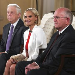 Ron Jarret, president of The Tabernacle Choir at Temple Square, left, and Mack Wilberg, music director of the choir, sit with guest artist Kristin Chenoweth as they share exclusive details about this year's Christmas concert during press conference at the Relief Society Building in Salt Lake City on Wednesday, Dec. 12, 2018.