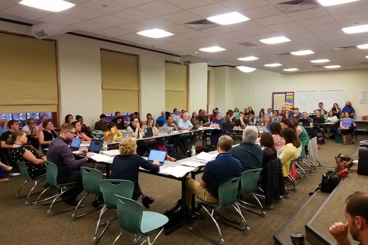 The bargaining teams from Denver Public Schools and the Denver teachers union at a contract negotiation session in 2017.