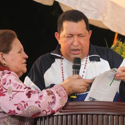 In this photo released by Miraflores Press Office, Venezuela's President Hugo Chavez, right, accompanied by his mother Elena Frias de Chavez, attends a mass in Barinas, Venezuela, Thursday, April 5, 2012. Chavez, who attended the mass accompanied by relatives Thursday after returning from his latest round of radiation therapy treatment in Cuba, vowed to overcome cancer and to run for re-election in October.
