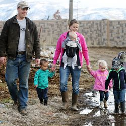 Addison Hicken with this wife, Jenn Hicken, walk with their three kids Ren, Laynie and Evan, and two nephews Parker and Weston Walton, on their farm in Heber City on Wednesday, March 11, 2020.