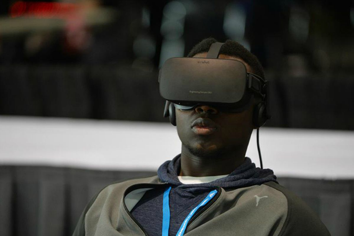 A man in an Oculus VR headset