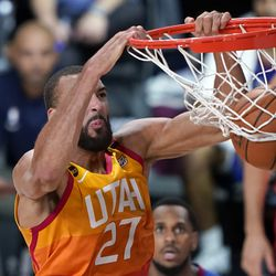 Utah Jazz's Rudy Gobert (27) dunks the ball against the Denver Nuggets during the second half of an NBA basketball first round playoff game Sunday, Aug. 23, 2020, in Lake Buena Vista, Fla.