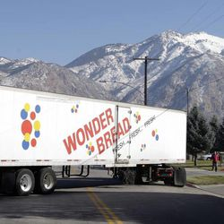 A Hostess Wonder Bread truck is shown in front of the Utah Hostess plant in Ogden, Utah, Thursday, Nov. 15, 2012. Hostess Brands Inc. is warning striking employees that it will move to liquidate the company if plant operations don't return to normal levels by Thursday evening.