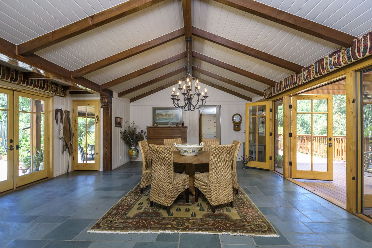 Formal dining room with vaulted ceiling