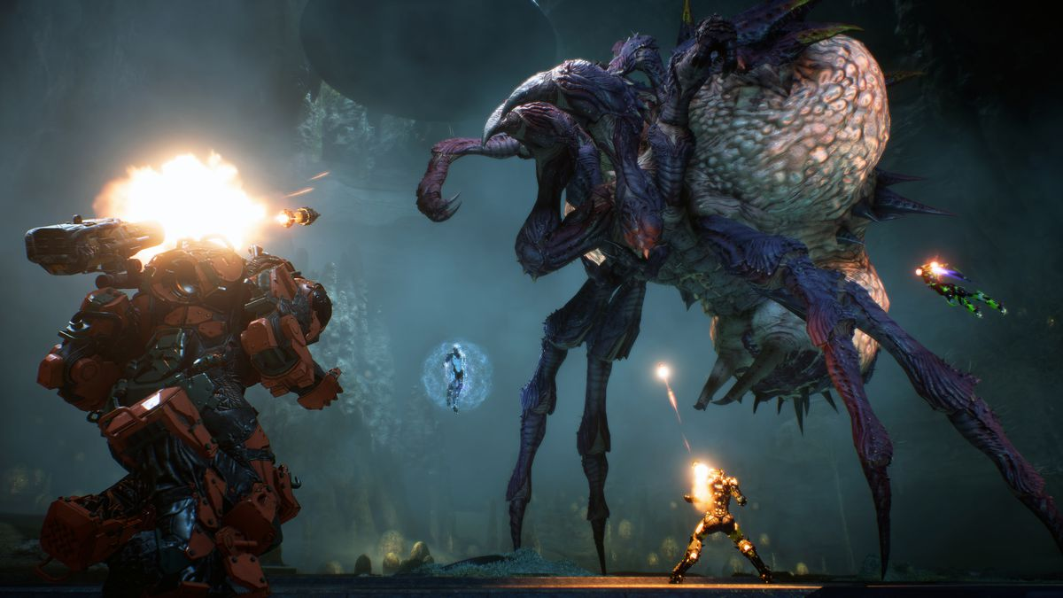 Anthem - four players fighting a giant arachnoid boss