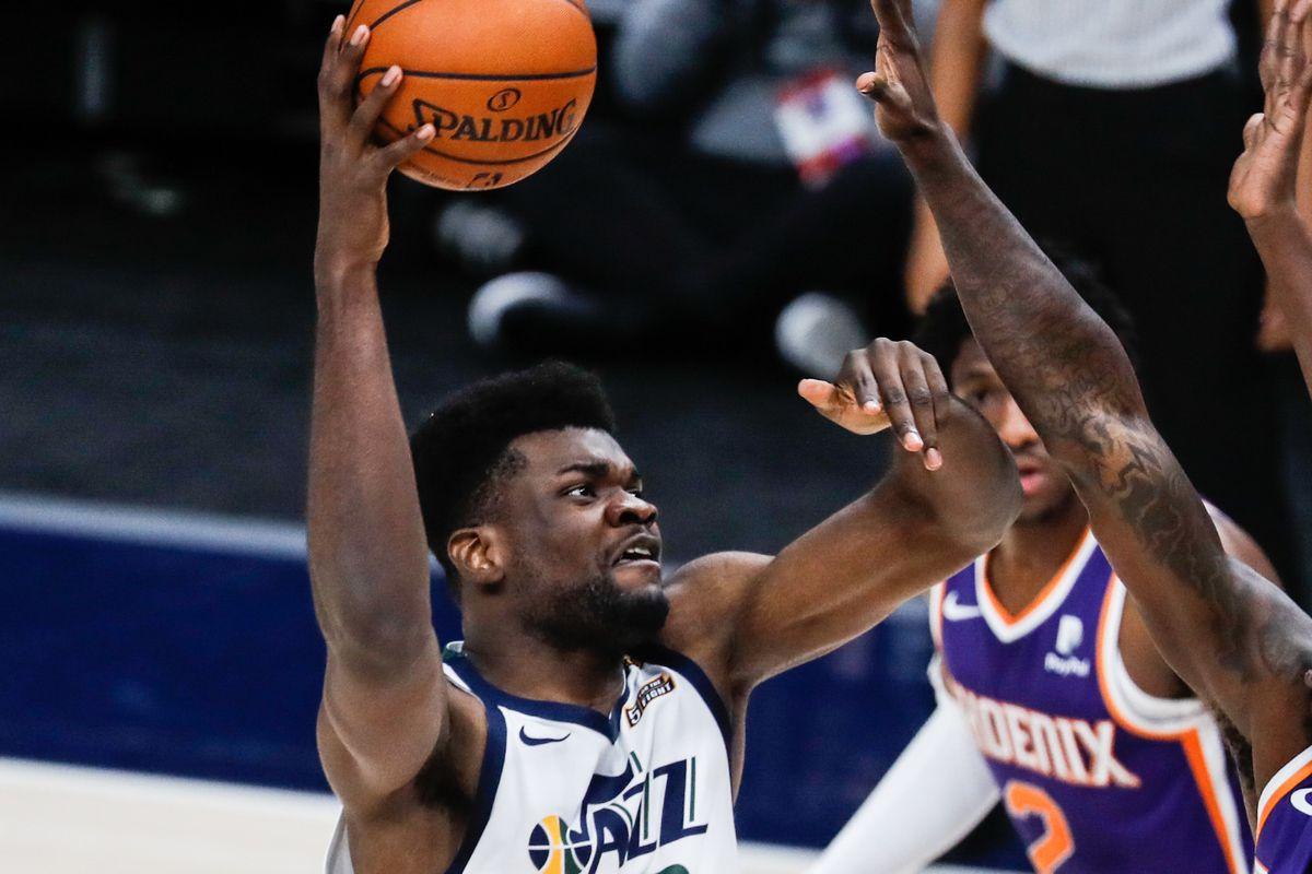 Utah Jazz center Udoka Azubuike (20) makes a shot against Phoenix Suns forward Johnathan Motley (12) during an NBA preseason game at Vivint Smart Home Arena in Salt Lake City on Saturday, Dec. 12, 2020.